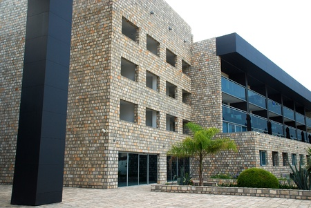 Contemporary hotel resort building - stone and glass