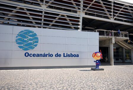 oceanarium: LISBON, PORTUGAL - SEPTEMBER, 28: Entrance and signboard of modern Oceanarium building in Lisbon, Portugal on September 28, 2009. The Lisbon Oceanarium has a large collection of marine species (birds, mammals, fish). Editorial