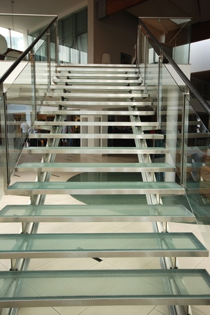 Modern glass staircase in contemporary hotel foyer