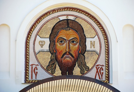 Mosaic classical icon of Jesus Christ in byzantine style on the white orthodox church wall
