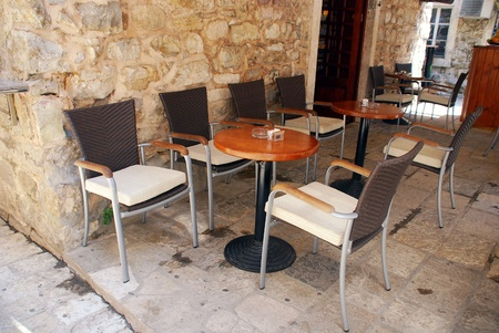 tables and chairs on outdoors cafe in Mediterranean Europe