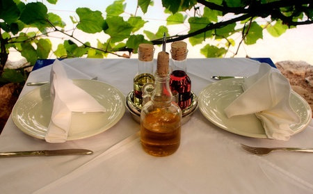 Outdoor italian restaurant table with served settings.