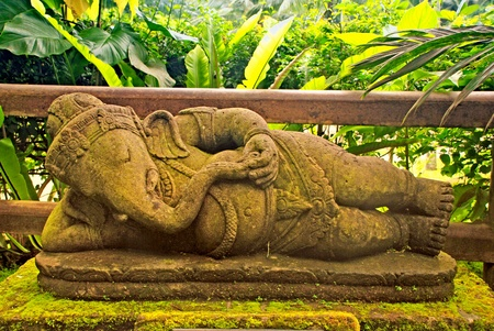Old stone statue of Ganesha, a hindu symbol of luck (Indonesia).