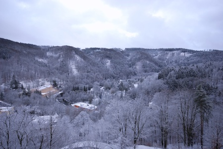 Magic view of a snow-covered forest hills (Chezh Republic). photo