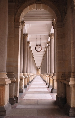 Perspective view of classical promenade with columns and clock(Karlovy Vary, Czech Republic)