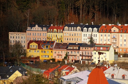 karlovy: Multicolored european buildings, hotels and apartments on the forest hills in famous Karlovy Vary(Czech Republic) . Autumn time.