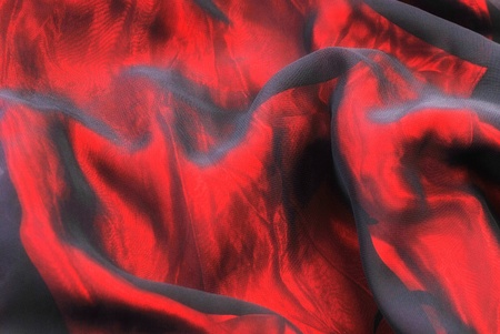 organza: Red folded shiny organza background.