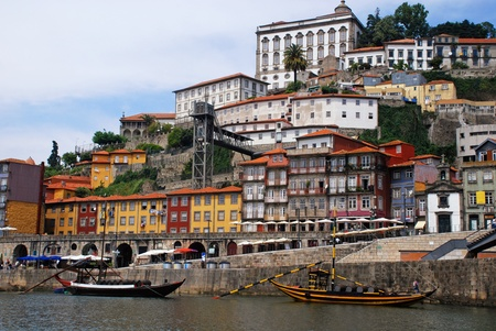 barrel tile: View of Porto city at the riverbank (Ribeira quarter) and wine boats(
