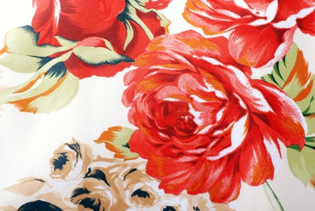 Silk floral fabric with red rose flowers on a beige background. Stock Photo