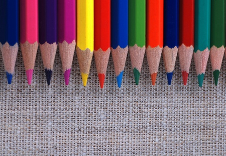 row of multicolored pencils on canvas background Stock Photo - 12231575