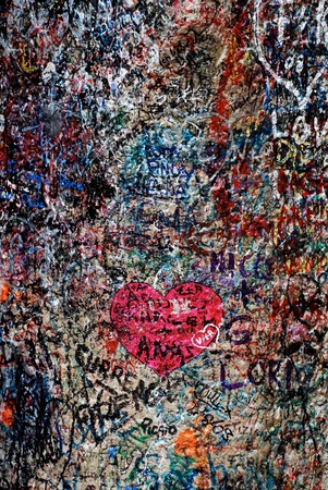 Vertical image with love messages and hearts on the famous wall of Juliet and Romeo house(Verona, Italy)