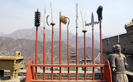 traditional weapon: ancient  chinese spears and sculpture of terracotta soldiers on Great Wall(China)