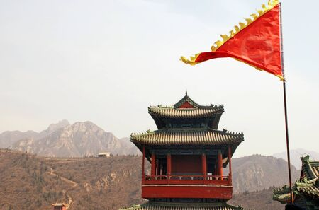 independent mongolia: landscape with red flag and pagoda on Great Wall China