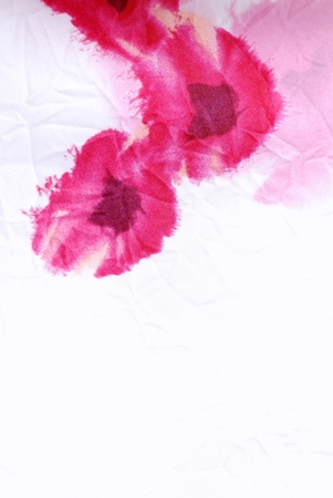 Vertical silk floral crumpled fabric background with red poppies . photo