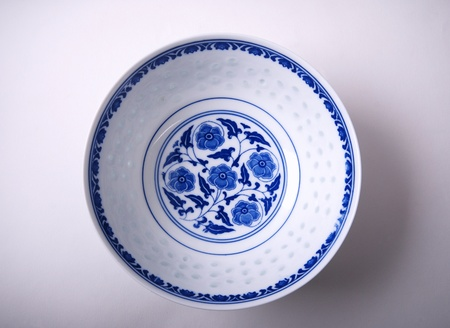 1 object: Directly above an empty blue china bowl Stock Photo