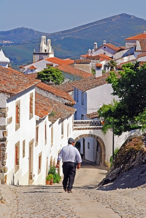 Narrow street with traditional white houses in medieval village Marvao (Portugal, Alentejo) photo