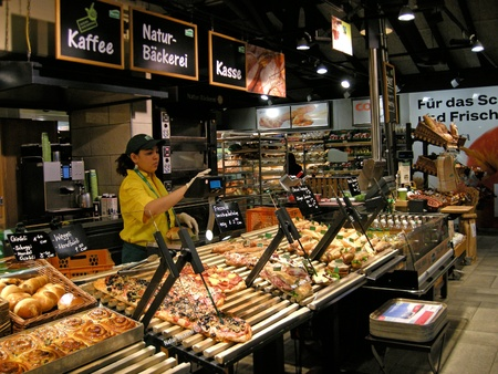 Zurich, Switzerland - January 22, 2012: Vendor at self service bakery Marche in Switzerland. Marche stands for healthy nutrition and offers food that is cooked right before eyes with seasonal products from the region and not to use any additives or preser