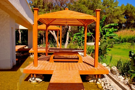 Landscape with wood pavilion for massage in tropical garden  photo