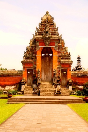 Main entrance of Taman Ayun Temple in Mengwi (Bali, Indonesia). Originally dated from 1634. Vertical image photo