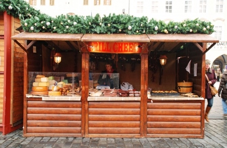 Prague,Czech Republic-December 29,2011:  The Prague Christmas market on the Old Town Square consist of brightly decorated wooden huts selling traditional Czech products from hot food and handicrafts.The atmosphere in Prague in December is simply wonderful