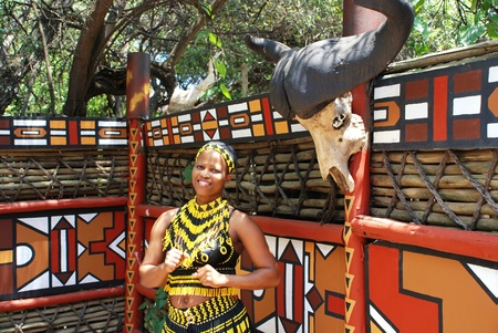 LESEDI CULTURAL VILLAGE, SOUTH AFRICA - JAN 1: Zulu woman wearing handmade clothing on January 1, 2008 at the Lesedi Cultural Village in South Africa. Beads are a pride of the Zulu nation.
