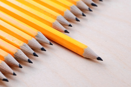 Diagonal group of pencils with one highlighted. Selective focus Stock Photo - 13606836