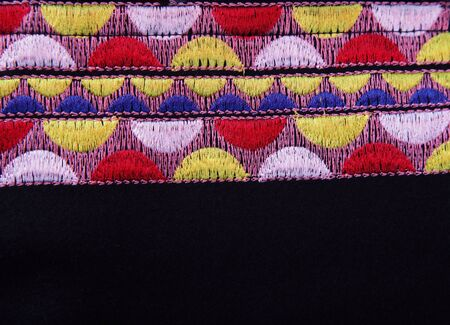 stitchwork: Black background with multicolored embroidery