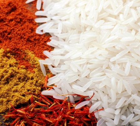 White rice and indian spices(curry and saffron) background. square image, selective focus Stock Photo - 13698418