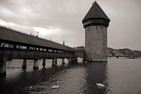 Chapel Bridge - famous landmark of Lucerne in winter. Chapel Bridge is the oldest wooden bridge in Europe, originally built in 14th century. Sepia toned image photo