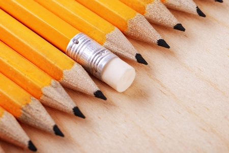 Diagonal group of pencils with eraser on wood background. Selective focus Stock Photo - 14006315