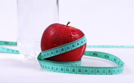 horizontal image with wet apple, measurement and mineral water Stock Photo - 14006314