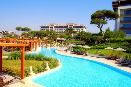 panoramic  hotel resort view with pools and garden in summer