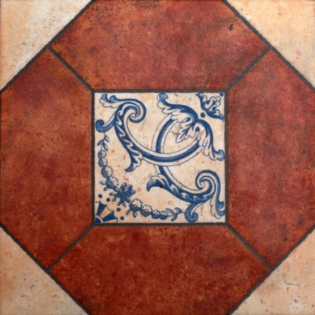 Terracotta tile with blue ornate spanish pattern photo