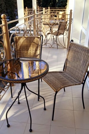 Iron table and chairs on summer resort balcony  photo