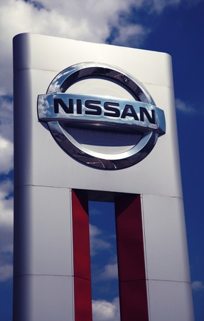 LUGANSK, UKRAINE - JUNE 08: Silver Nissan car logo dealership sign on June 08, 2012 in Lugansk, Ukraine.
