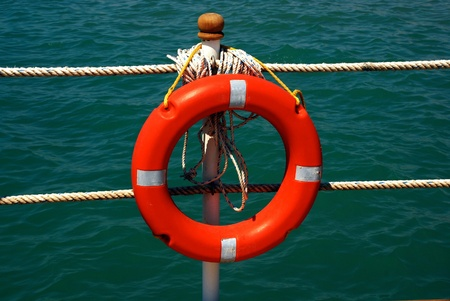 red lifebuoy on a sea background photo