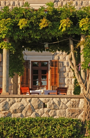 beautiful outdoor cafe on summer terrace (Italy) photo