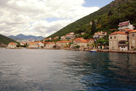 Old fishing village with traditional mediterranean stone houses in the Kotor Bay(Boka Kotorska), Montenegro. photo