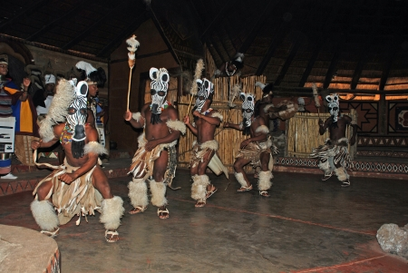 LESEDI VILLAGE, SOUTH AFRICA - DECEMBER 01: A group of South African Zulu dancers in ritual costumes entertaining for tourists on December 01, 2008 at the Cultural Village Lesedi, South Africa.
