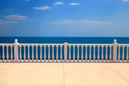 Summer view with classic white balustrade and empty terrace overlooking the sea  Italy  Stock Photo