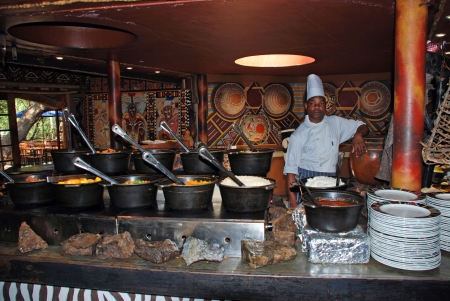 LESEDI VILLAGE, SOUTH AFRICA - JANUARY 1: African cook in tribal restaurant cooking tradition african ethnic food - meat and vegetable - on  January 01, 2008 in Lesedi African Lodge and Cultural village, South Africa