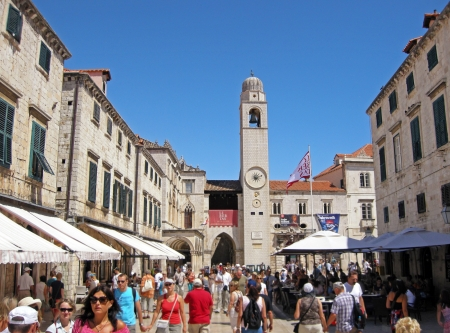 Dubrovnik, Croatia - Jule 20, 2011 : Tourists walking on the main street Stradun in the old town of Dubrovnik, Croatia. Many of the historic buildings and monuments in Dubrovnik are situated along the Stradun, because of which it serves as a popular espla
