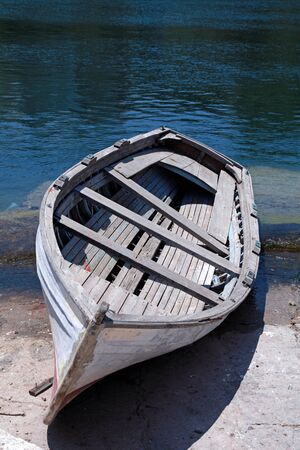 skiff: Abandoned old wooden boat at a Mediterranean sea(Greece)