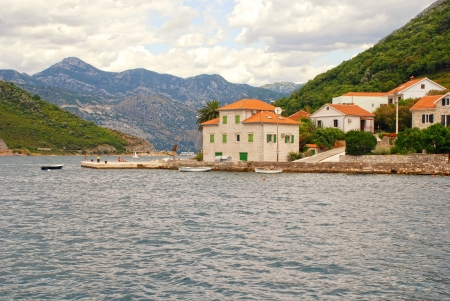Old fishing village with pier and traditional mediterranean stone houses in the Kotor Bay(Boka Kotorska), Montenegro. photo