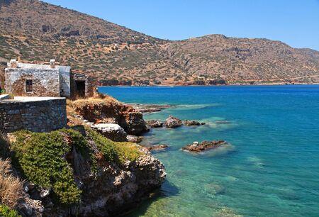 Beautiful Mediterranean sea coast with turquoise waters and scenic stone hut at Crete island, Greece. photo