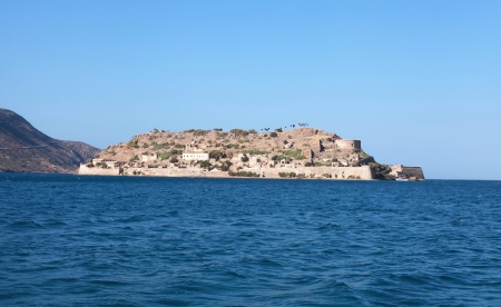 Spinalonga is a small island near Elounda in East Crete. Spinalonga  is also known as the Leper Island, as that is where lepers from Crete and the rest of Greece were quarantined until 1957.Today thousands of tourists visit Spinalonga each summer by boat  photo