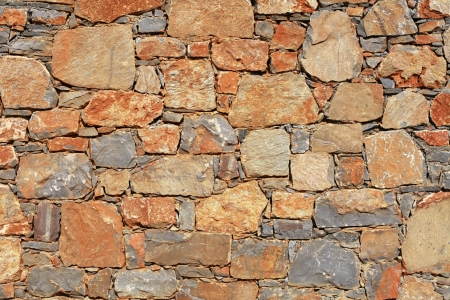 rough mediterranean stone wall as background. Stock Photo - 15260474