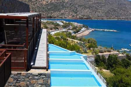 Summer sea resort with balkony and row of private swimming pools(Greece)