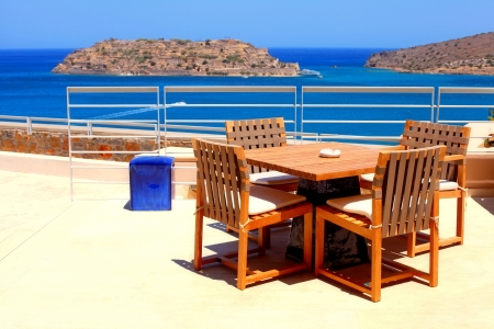 Terrace sea view with outdoor wood chairs and table Stock Photo - 15260411