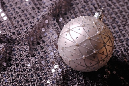 Silver Christmas ball on a shine background. Selective focus. photo